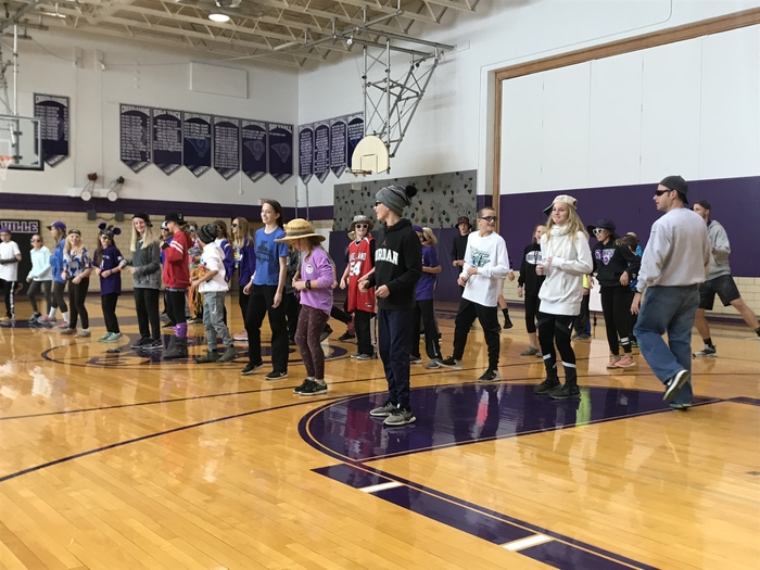 X-C celebrating going to state with a Pep Assembly dance featuring Ice, Ice Baby!