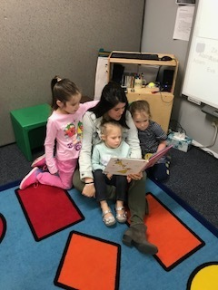 Mrs. McDonald reads to students